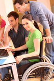 Woman in wheelchair attending group meeting — Stok fotoğraf