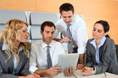 Business meeting in office with electronic tablet — Stock Photo
