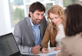 Couple signing property contract — Stock Photo