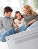 Family watching movie on television — Stock Photo
