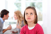 Portrait of upset child with parent's fighting — Foto Stock