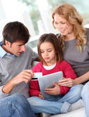 Family doing online shopping with tablet — Stock Photo