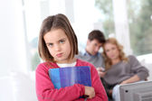 Upset little girl who has to do homeworks — Stock Photo