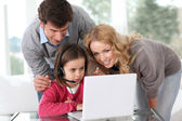 Family at home using computer webcamera — Stock Photo
