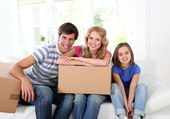 Family moving in new house — Stock Photo