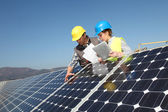 Man showing solar panels technology to student girl — Stock Photo