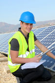 Young adult doing professional training on solar panels plant — Stock Photo
