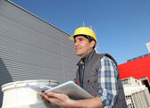 Foreman on industrial site with tablet — Stock Photo