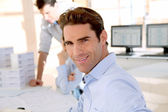 Young smiling and cheerful businessman — Stock Photo