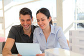 Happy young couple signing property purchase contract — Stock Photo