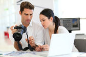 Work meeting in photo agency — Stock Photo