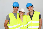 Portrait of cheerful construction team — Stock Photo