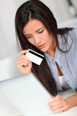 Young woman doing online shopping with tablet — Stock Photo