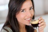 Portrait of beautiful woman drinking espresso — Stock Photo