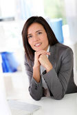 Businesswoman sitting in front of laptop computer — Stock Photo