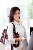 Beautiful modern woman buying with credit card — Stock Photo