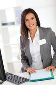 Portrait of beautiful smiling hostess — Stock Photo