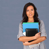 Student holding pile of files — Stock Photo