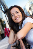 Portrait of beautiful smiling woman in town — Stock Photo