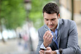Businessman in the street talking on the phone — Foto Stock