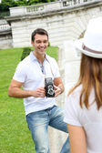 Man taking picture of girlfriend during journey — Stock Photo