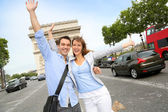 Cheerful couple on the Champs Elysees Avenue — Stock Photo