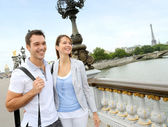 Couple in Paris walking on the bridge Alexander the Third — Photo
