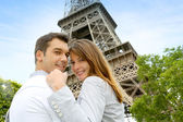 Couple embracing each other in front of the Eiffel tower — Stock Photo