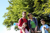 Portrait of happy family on a trekking day — Stock Photo