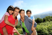 Parents and children standing in natural landscape — Stock Photo
