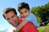 Portrait of father and son having fun in the mountain — Stock Photo