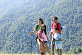 Family on a trekking day in the mountains — Stock Photo