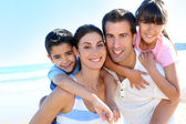 Closeup of happy family at the beach — Foto de Stock