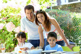 Closeup of happy family having lunch in garden — Stock Photo