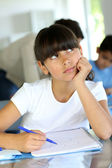 Young school girl with bored look on her face — ストック写真