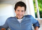 Portrait of cheerful young guy with blue eyes — Stock Photo