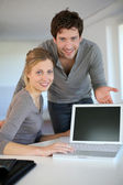 :Young home students presenting e-learning service — Stock Photo