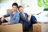 Young couple moving in their home — Stock Photo