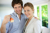 Closeup of happy new property owners — Stock Photo
