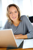 Woman working on laptop from home — Stock Photo