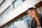 Portrait of woman using tablet in town — Stock Photo