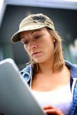 Woman using tablet in town — Stock Photo