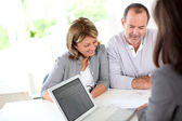 Senior couple ready to buy new house reading contract — Stock Photo