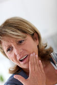 Closeup of senior woman having toothache — Stock Photo