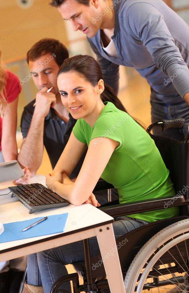 Woman in wheelchair attending group meeting  Stock Photo #13932186