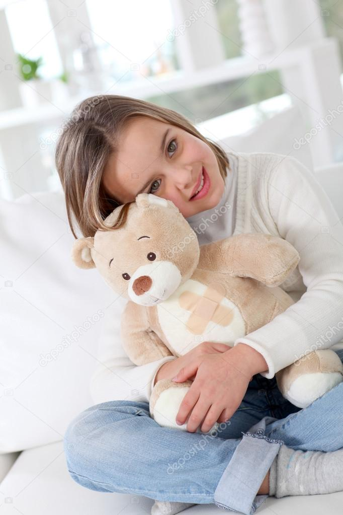Sick little girl hugging sick teddy bear — Stock Photo #13932722