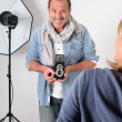 Photographer in photo session in studio — Stock Photo