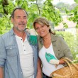 Happy senior couple gardening together - Stock Photo
