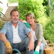 Happy senior couple gardening together — Stock Photo