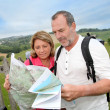 Stock Photo: Retired reading map on trekking day